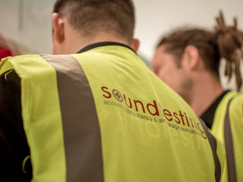 two soundtesting engineers wearing hi vis vests