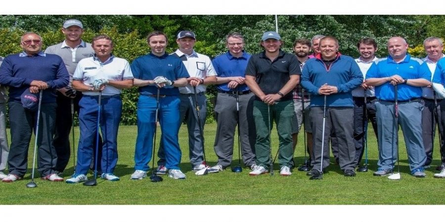 The Construction golf teams gathered on the first tee