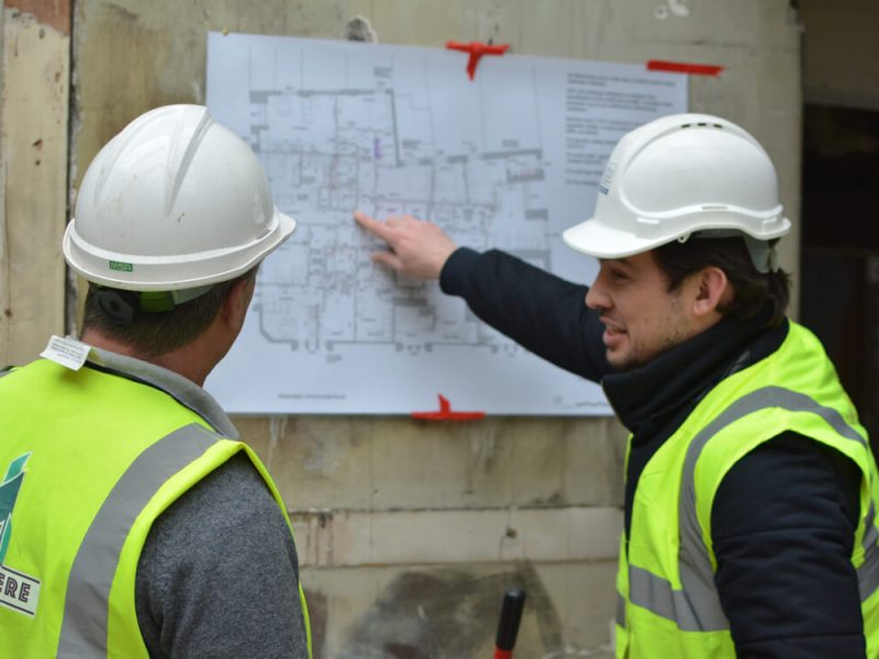 Jonathan Howell and Customer discussing plans onsite for Noise requirements