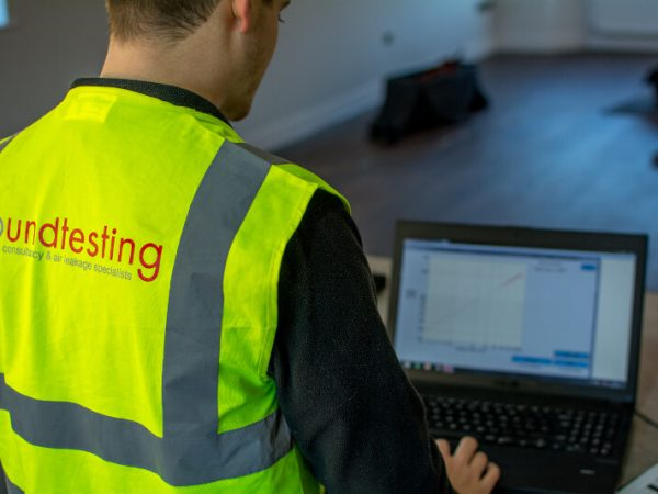 Sound Testing Engineer meauring air pressure at new build house