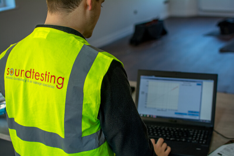 Engineer completing an air leakage test at new build house