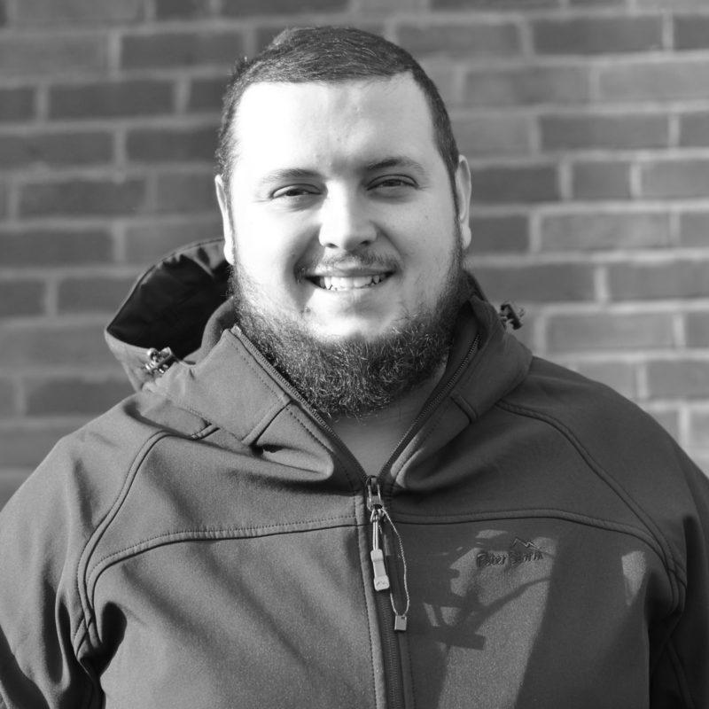 Jack Keehn wearing a Soundtesting jacket, smiling at the camera